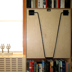 Prefinished plywood drop-down desk with laser-cut plywood radiator cover