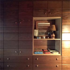 New drawers retrofit into an existing Walnut plank wall