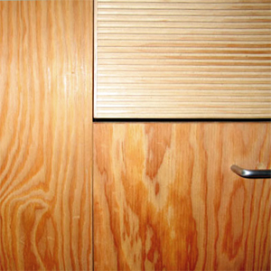Custom textured fir drawer and marine plywood cabinets